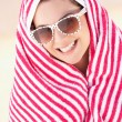 Woman Sheltering From Sun On Beach Holiday — Stock Photo