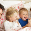 Family Relaxing Together In Bed — 图库照片