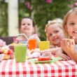 Group Of Children Enjoying Outdoor Tea Party — Stock Photo #24639147