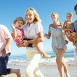 Multi Generation Family Enjoying Beach Holiday — Stock Photo #24639207