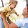 Father And Son Playing In Summer Garden — Stock Photo #24639219