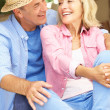 Senior Couple Sitting Outside House — Stock Photo