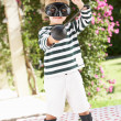 Stock Photo: Young Boy Wearing Wellington Boots And Fancy Dress Costume