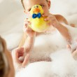 Mother And Daughter Relaxing In Bubble Filled Bath — Stock Photo #24639323