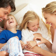 Family Relaxing Together In Bed — Stock Photo #24639325