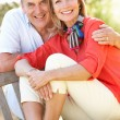 Senior Couple Sitting Outdoors On Bench — Stock Photo