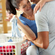 Romantic Couple Sorting Laundry In Kitchen — Stock Photo