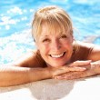 Senior Woman Having Fun In Swimming Pool - Photo