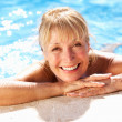 Senior Woman Having Fun In Swimming Pool — Stock Photo #24639373