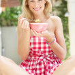 Woman Enjoying Bowl Of Breakfast Cereal - Foto de Stock
