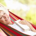 Senior Woman Relaxing In Hammock — Stock Photo #24639499