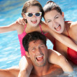 Stock Photo: Family Having Fun In Swimming Pool