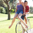 Stock Photo: Couple Enjoying Cycle Ride