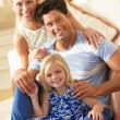 Family Relaxing On Sofa At Home — Stock Photo
