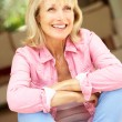 Senior Woman Sitting Outside House — Stock Photo