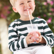 Young Boy Wearing Wellington Boots Drinking Milkshake — Stock Photo #24639741