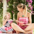 Mother And Daughter Enjoying Breakfast Cereal Outdoors Together — Stock Photo