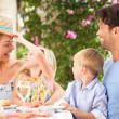 Family Enjoying Meal outdoorss — Stock Photo