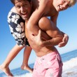 Stock Photo: Father And Son Having Fun On Beach