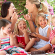 Children And Mothers Eating Jelly And Cake At Outdoor Tea Party - Foto de Stock