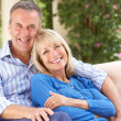 Stock Photo: Senior Couple Relaxing On SofAt Home