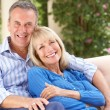 Senior Couple Relaxing On Sofa At Home — Foto Stock