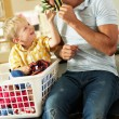 Father And Son Sorting Laundry Sitting On Kitchen Counter — Stock Photo