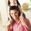 Father Giving Daughter Ride On Shoulders Indoors — Stock Photo