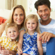Stock Photo: Family Relaxing On Sofa At Home