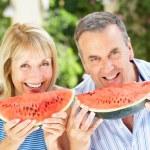 Senior Couple Enjoying Slices Of Water Melon — Stock Photo