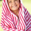 Girl Wrapped In Towel Sitting In Garden - Foto de Stock