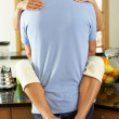 Romantic Senior Couple Hugging In Kitchen — Stock Photo #24639861