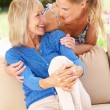 Senior Woman With Adult Daughter Relaxing On Sofa At Home — Stock Photo