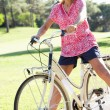 Senior Woman Enjoying Cycle Ride - Stock Photo
