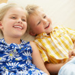 Two Children Lying Upside Down On Sofa At Home — Stock Photo #24639979