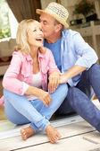 Senior Couple Sitting Outside House — Stock Photo