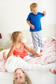 Children Bouncing On Bed — Stock Photo