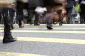 Close Up Of Commuters Feet Crossing Busy Hong Kong Street — Stock Photo