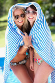 Two Women Wrapped In Towel Standing By Swimming Pool — Stock Photo