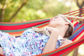 Woman Relaxing In Hammock With Book — Stock Photo