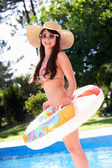 Woman Standing By Pool With Inflatable Ring — Stock Photo
