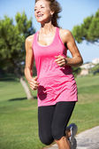 Senior Woman Exercising In Park — Foto Stock