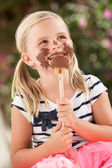 Young Girl Covered In Chocolate Licking Spoon — Stock Photo