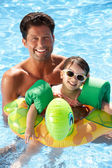 Father And Daughter Having Fun In Swimming Pool — Stock Photo