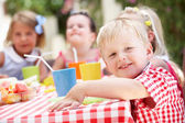 Group Of Children Enjoying Outdoor Tea Party — Stock Photo