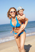 Mother And Son Running Along Beach — Stock Photo