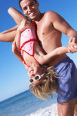 Father And Daughter Having Fun On Beach — Stock Photo