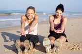 Two Women Exercising On Beach — Stock Photo
