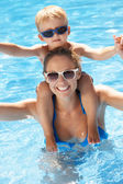 Mother And Son Having Fun In Swimming Pool — 图库照片