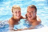 Senior Couple Having Fun In Swimming Pool — Stock Photo